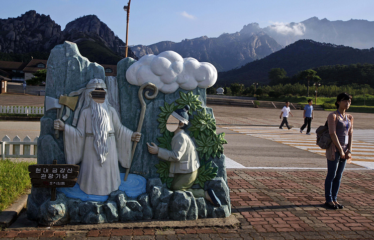 A visitor stands near a tourist attraction in the tourist center in Mount Kumgang in North Korea