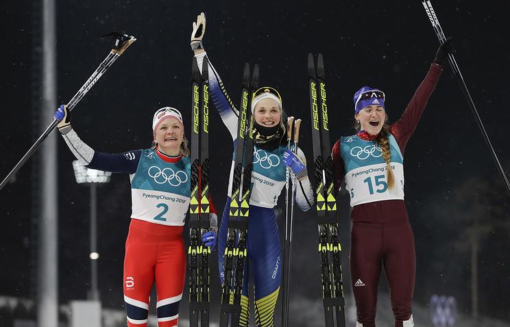 Silver medal winner Maiken Caspersen Falla, gold medal winner Stina Nilsson and bronze medal winner Yulia Belorukova