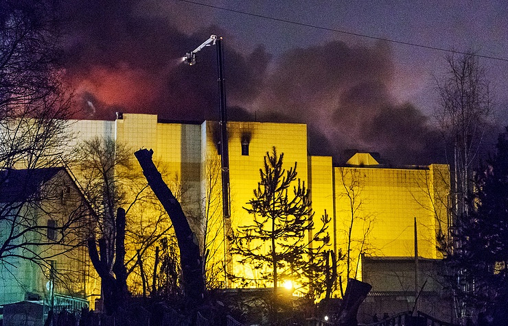Russians mourn at first funerals for mall fire victims as fury mounts