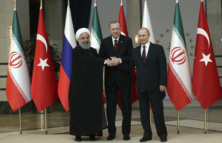 Iran's President Hassan Rouhani, Russia's President Vladimir Putin and Turkey's President Recep Tayyip Erdogan