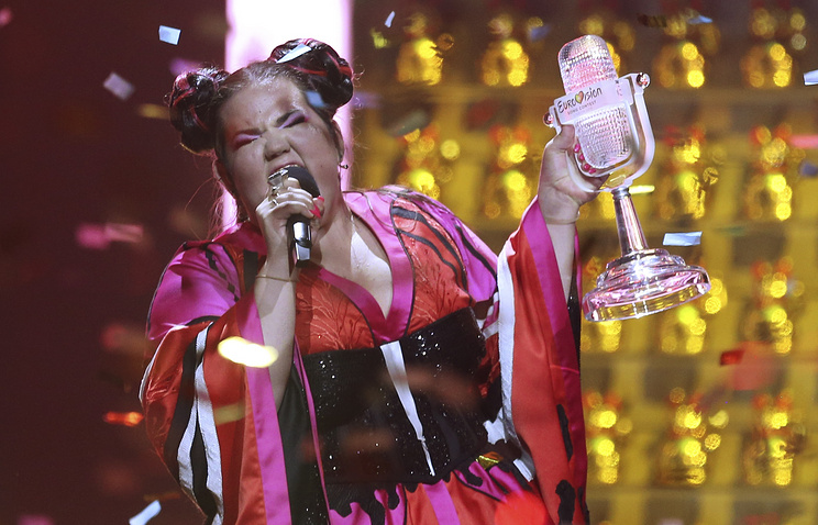 Netta from Israel celebrates after winning the Eurovision song contest in Lisbon, Portugal