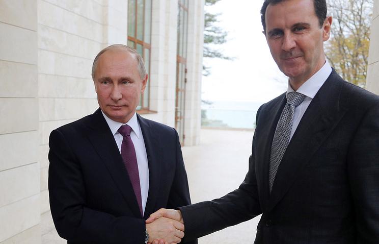 Russian and Syrian Presidents Vladimir Putin and Bashar al-Assad
