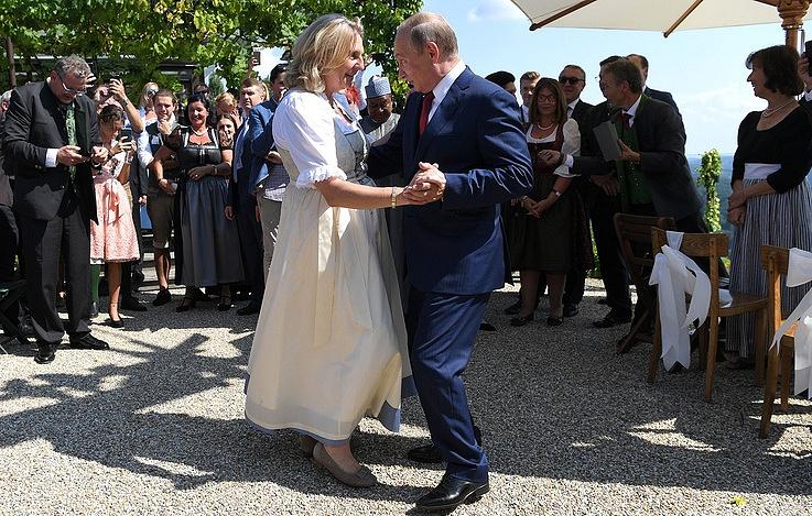 Austria's Foreign Minister Karin Kneissl and Russian President Vladimir Putin