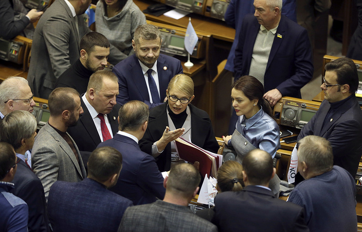 Ukrainian lawmakers seen during parliament session in Kiev