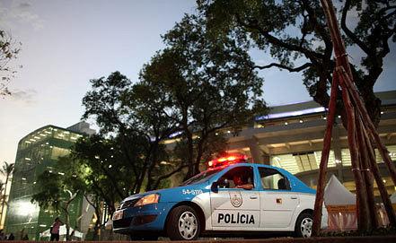 Фото EPA/ANTONIO LACERDA