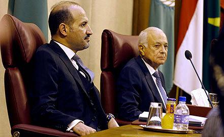 Ахмед аль-Джарба (слева) на заседании Совета глав МИД ЛАГ в Каире. Фото AP Photo/Amr Nabil