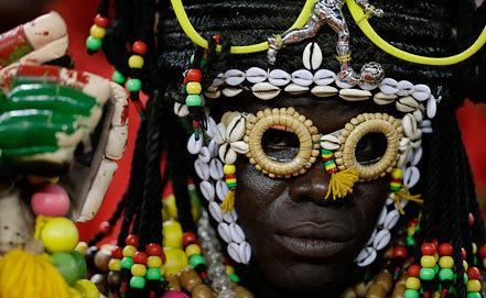 Нигерийский футбольный болельщик. AP Photo/Rebecca Blackwell