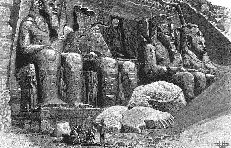 Огромные статуи при древнеегипетском пещерном храме