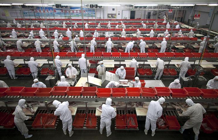 Работники на заводе Shuanghui International