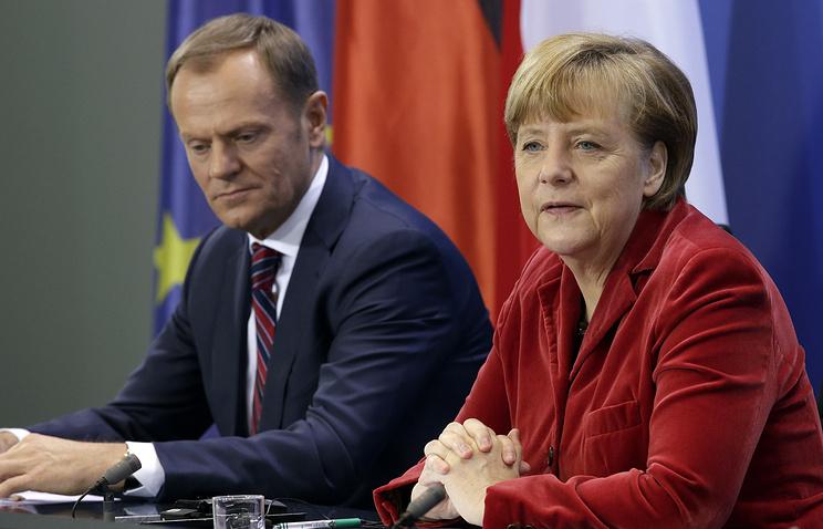 Премьер-министр Польши Дональд Туск и канцлер Германии Ангела Меркель на встрече с журналистами