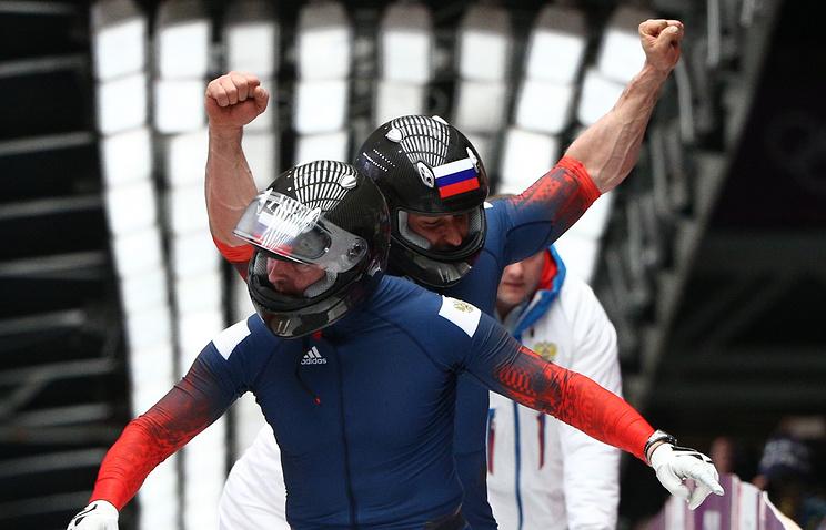 Александр Зубков и Алексей Воевода на финише победного заезда
