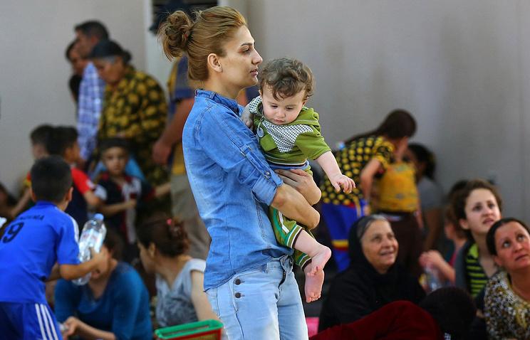 Иракские христиане в лагере для беженцев