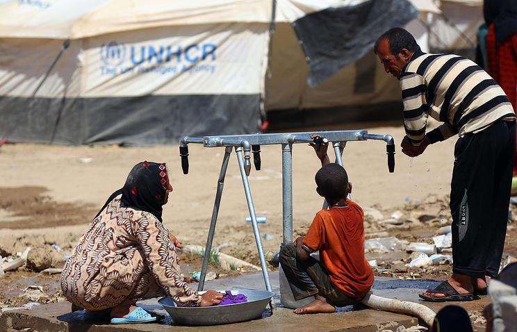 Лагерь беженцев недалеко от города Мосул, север Ирака, 25 июня 2014 года