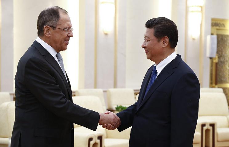 Глава МИД России Сергей Лавров и председатель КНР Си Цзиньпин
