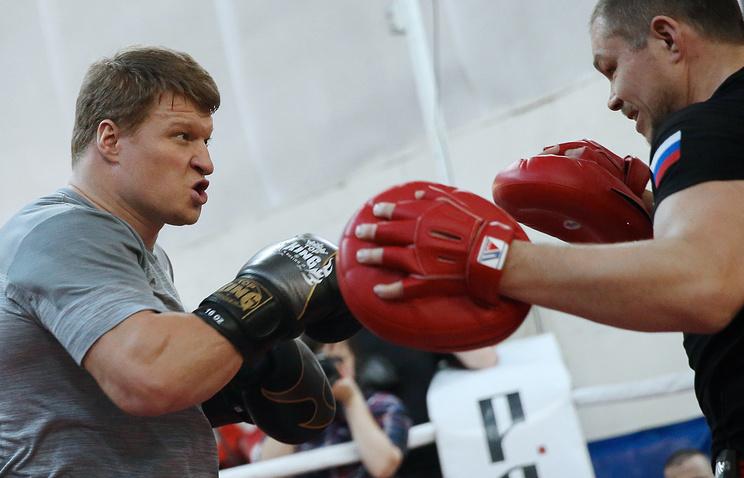 Александр Поветкин и тренер Иван Кирпа (слева направо)