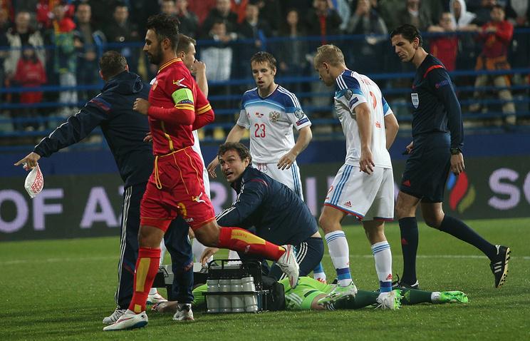 Эпизод из отборочного матча Евро-2016 между сборными Черногории и России