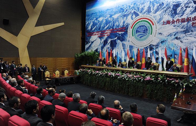 Во время заседания ШОС, 12 сентября 2014 года