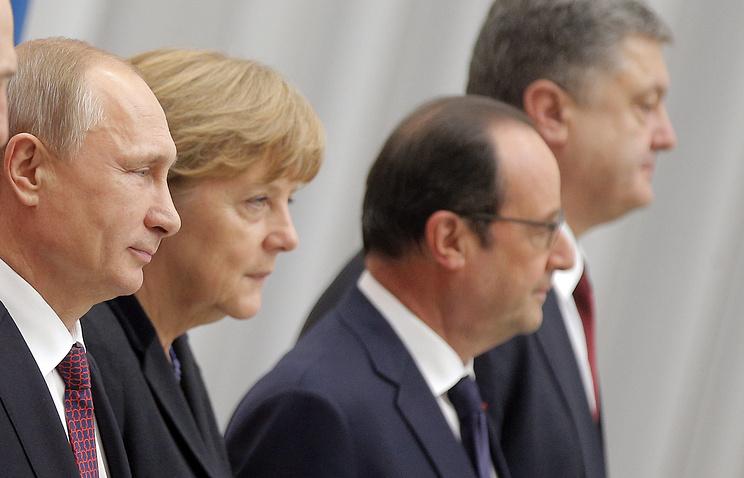 Президент РФ Владимир Путин, канцлер Германии Ангела Меркель, президент Франции Франсуа Олланд и президент Украины Петр Порошенко
