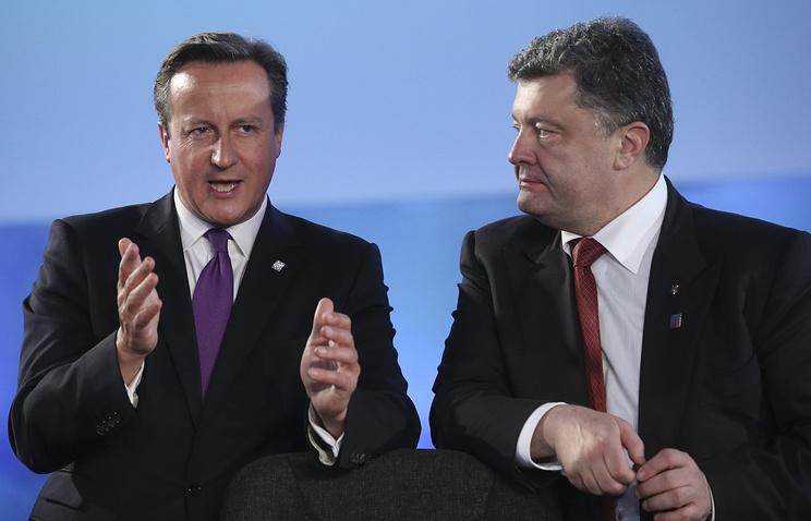 Премьер-министр Великобритании Дэвид Кэмерон и президент Украины Петр Порошенко