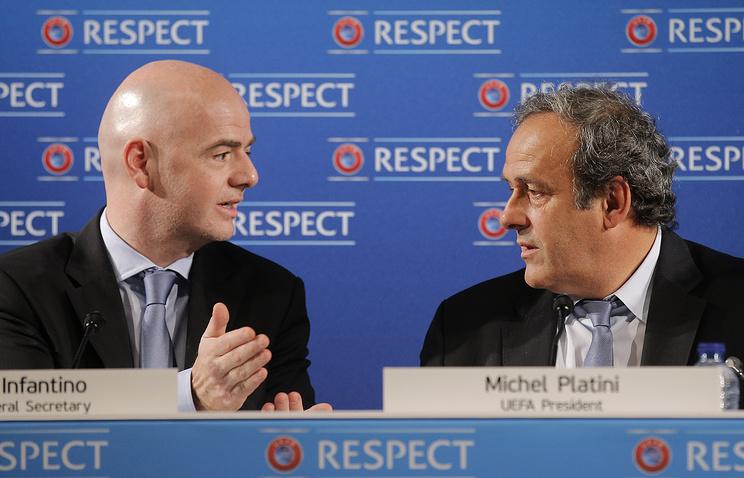 Генеральный секретарь Союза европейских футбольных ассоциаций (УЕФА) Джанни Инфантино и глава УЕФА Мишель Платини (слева направо)
