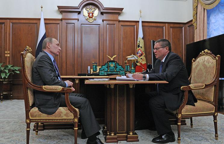 Президент РФ Владимир Путин и министр экономического развития РФ Алексей Улюкаев