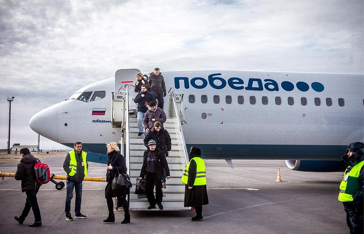 """Пассажиры самолета бюджетной авиакомпании """"Победа"""""""