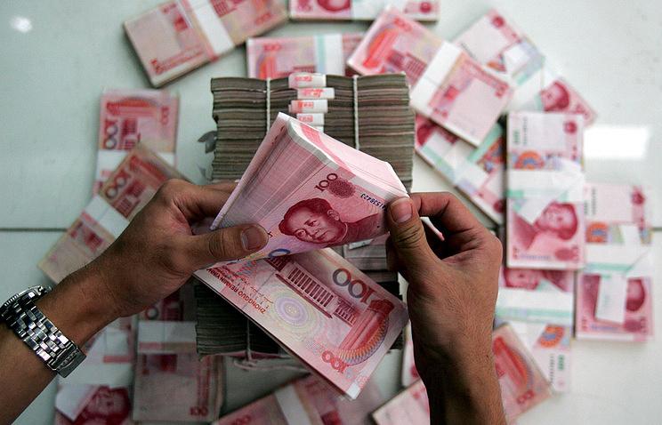 В Китайская народная республика юань понизился дорекордного с2010 года значения