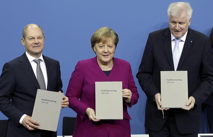 Ио сопредседателя СДПГ Олаф Шольц, председатель ХДС Ангела Меркель и лидер ХСС Хорст Зеехофер
