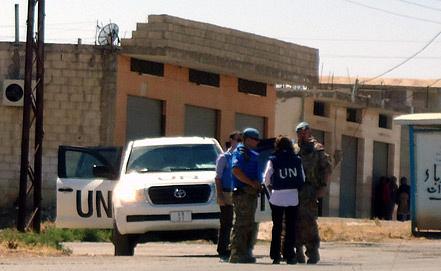 Эксперты ООН. Фото ЕРА/ИТАР-ТАСС