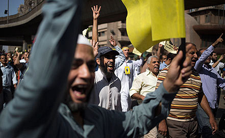 Беспорядки в центре Каира. Фото AP Photo/Hassan Ammar