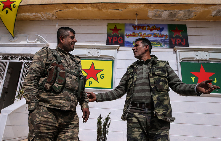 Kurdish militia members seen near the city of Azaz