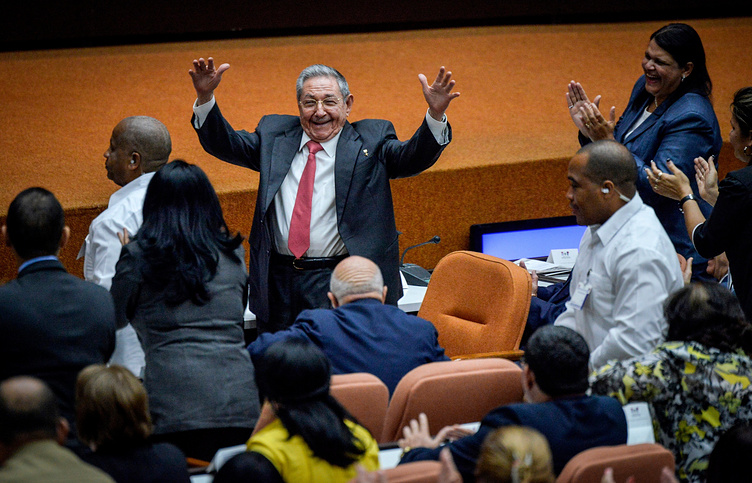 Raul Castro raises his arms in celebration after Miguel Diaz-Canel was chosen as Cuba's new president